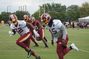 Tight ends Manasseh Garner and E.J. Bibbs take part in a drill. (Photo by Jake Russell)