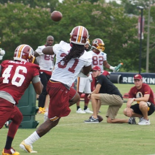 Running back Matt Jones makes the catch in front of Nico Marley. (Photo by Jake Russell)