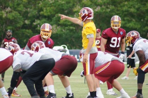 Quarterback Kirk Cousins directs the offense. (Photo by Jake Russell)