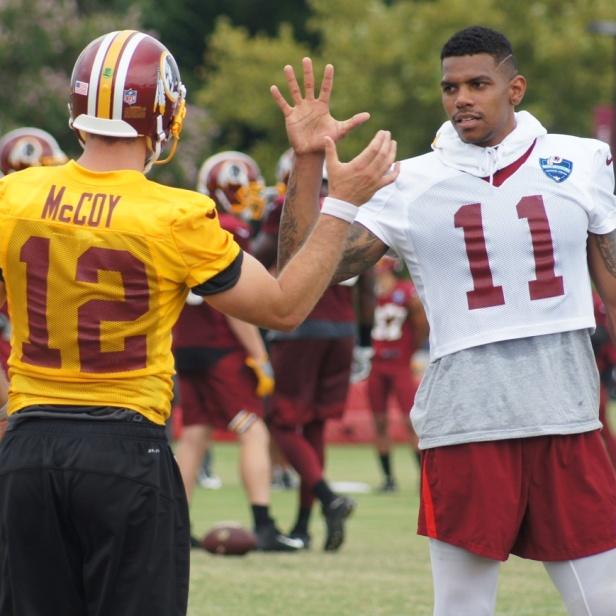 Quarterback Colt McCoy and wide receiver Terrelle Pryor greet each other. (Photo by Jake Russell)
