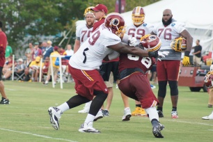 Offensive tackle Ty Nsekhe tries to keep linebacker Junior Galette at bay. (Photo by Jake Russell)