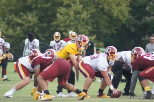 Colt McCoy leads the Redskins offense. (Photo by Jake Russell)