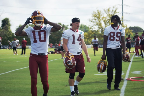 Wide receivers Paul Richardson, Trey Quinn and Cam Sims walk toward the sideline. (Photo by Jake Russell)