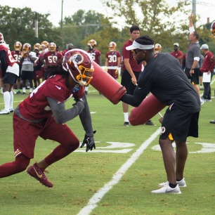Cornerback Adonis Alexander works on a special teams drill. (Photo by Jake Russell)