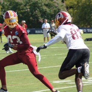 Cornerback Quinton Dunbar covers wide receiver Brian Quick. (Photo by Jake Russell)