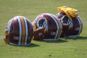 Redskins helmets along the sideline. (Photo by Jake Russell)