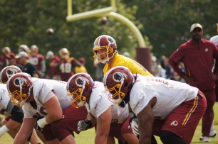 Quarterback Colt McCoy barks out a call at the line of scrimmage. (Photo by Jake Russell)