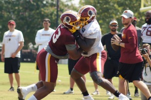 Defensive lineman Jonathan Allen and offensive lineman Isaiah Williams do battle. (Photo by Jake Russell)