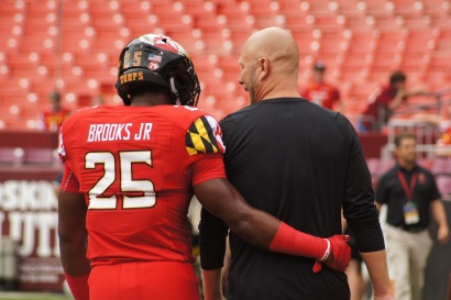 Maryland defensive back Antoine Brooks Jr. and interim head coach Matt Canada converse before the game. (Photo by Jake Russell)