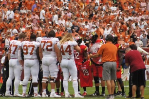 Maryland's captains hold up Jordan McNair's No. 79 jersey during the coin toss. (Photo by Jake Russell)