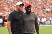 Maryland honorary captains Mark Agent and Vernon Davis pose for a photo. (Photo by Jake Russell)