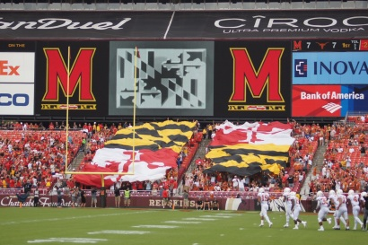 Fans display the Maryland state flag in the west end zone of FedEx Field. (Photo by Jake Russell)