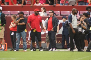 Former Baltimore Ravens linebacker Ray Lewis and Under Armour founder Kevin Plank hold court on the Maryland sideline. (Photo by Jake Russell)