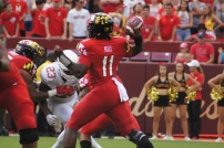 Terps quarterback Kasim Hill attempts a pass. (Photo by Jake Russell)