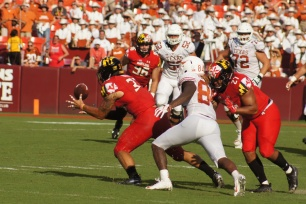 Maryland linebacker Tre Watson secures an interception. (Photo by Jake Russell)