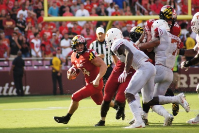 Maryland running back Jake Funk looks for an escape route in Texas' defense. (Photo by Jake Russell)