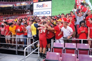 Terps running back Jake Funk celebrates with the Maryland student section. (Photo by Jake Russell)