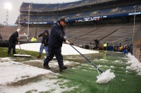 Beaver Stadium employees work to clear slush from the field. (Photo by Jake Russell)