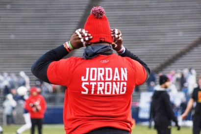 Maryland offensive lineman Tyran Hunt adjusts his beanie while wearing a shirt honoring fallen teammate Jordan McNair. (Photo by Jake Russell)