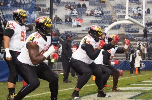 Maryland's offensive line gets in some pregame reps. (Photo by Jake Russell)
