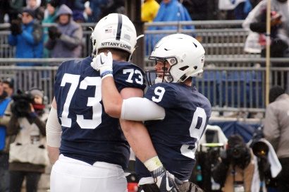 Nittany Lions quarterback Trace McSorely and offensive lineman Mike Miranda celebrate McSorley's touchdown run. (Photo by Jake Russell)