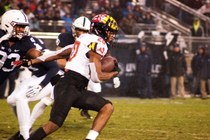 Terps running back Javon Leake tries to avoid Penn State defenders. (Photo by Jake Russell)