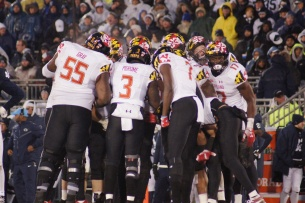The Terps huddle up. (Photo by Jake Russell)