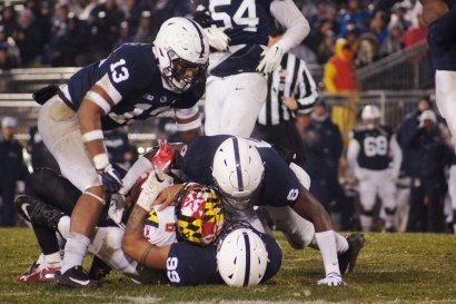 Maryland wide receiver Jashaun Jones is wrangled by Penn State defenders. (Photo by Jake Russell)