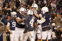 The Nittany Lions celebrate running back Ricky Slade's first rushing touchdown of the game. (Photo by Jake Russell)
