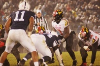 Maryland quarterback Tyrell Pigrome prepares to run a play. (Photo by Jake Russell)