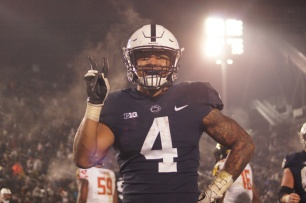 Penn State running back Ricky Slade celebrates his second rushing touchdown of the game. (Photo by Jake Russell)