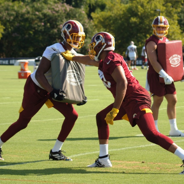 Montez Sweat practices a drill. (Photo by Jake Russell)