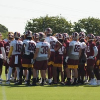 The Redskins huddle up. (Photo by Jake Russell)