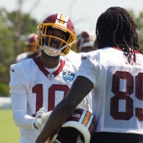 Wide receiver Paul Richardson talks shop with Cam Sims. (Photo by Jake Russell)