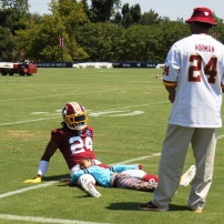 Josh Norman enjoys his post-practice stretches. (Photo by Jake Russell)