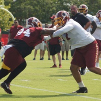 Defensive lineman Daron Payne matches up against offensive lineman Ereck Flowers. (Photo by Jake Russell)