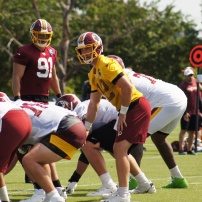 Quarterback Colt McCoy calls a play at the line of scrimmage. (Photo by Jake Russell)